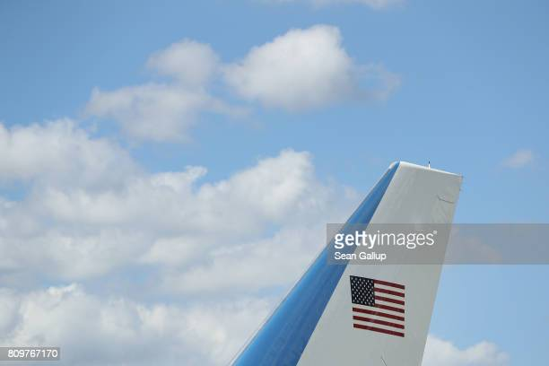 S flag adorns the vertical stabilizer of Air Force One carrying US President Donald Trump and First Lady Melania Trump upon its arrival at Hamburg...
