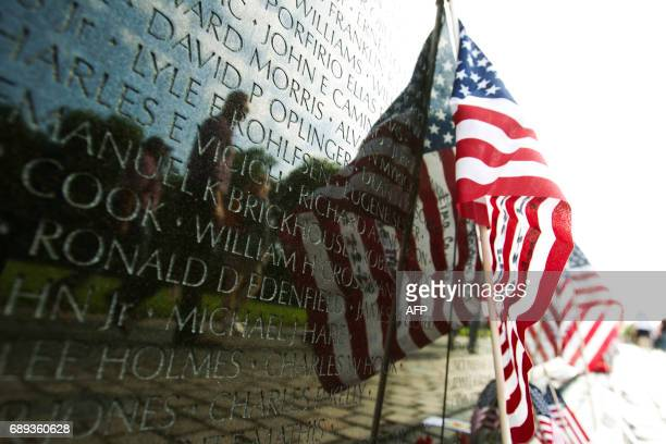 A US flag adorns the wall of the Vietnam Veterans Memorial in Washington DC May 28 2017 Motorcyclists are in Washington for the traditional annual...