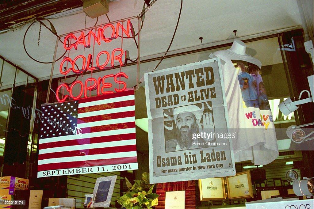 Flag and Bin Laden Poster in Window : Stock-Foto