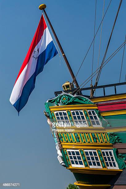 Flag and colorful stern of The Amsterdam . The Amsterdam was an 18th-century cargo ship of the Dutch East India Company.