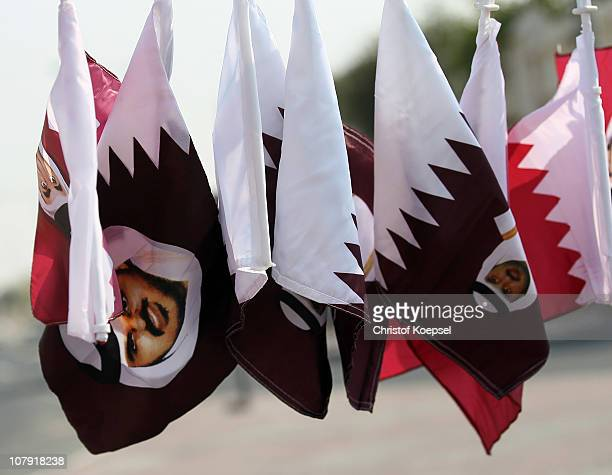 Flag and scarves of Qatar are seen after the FC Bayern Muenchen training session at Aspire Academy for Sports Excellence training ground on January 7...