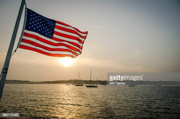 flag at sunset - american flag ocean stock pictures, royalty-free photos & images
