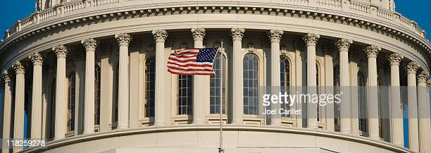 us flag at capitol - house of representatives stock pictures, royalty-free photos & images