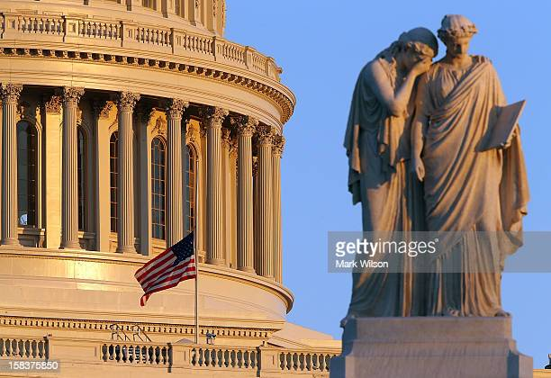 A flag at the US Capitol has been lowered to half staff after President Barack Obama ordered the action while speaking on the shootings at the Sandy...