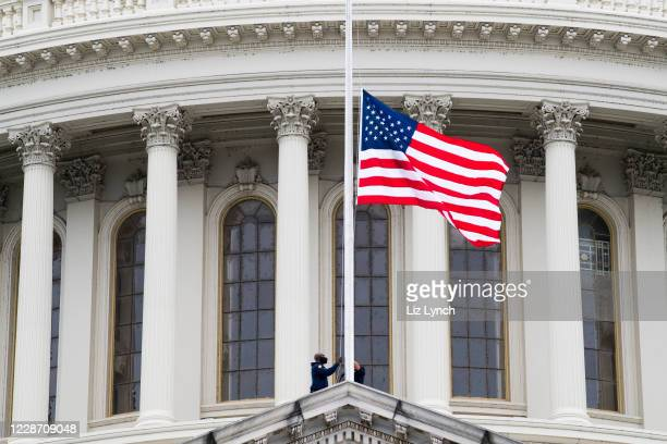 Flag at the U.S. Capitol is lowered to half-mast in honor of Associate Justice Ruth Bader Ginsburg on September 25, 2020 in Washington, DC. Ginsburg,...