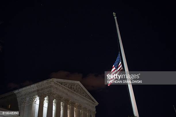 A flag at the US Supreme Court is lowered to half staff February 13 2016 in Washington DC following the announcement of the death of Supreme Court...
