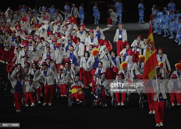 Flag bearear Jose Manuel Ruiz Reyes of Spain leads the team entering the stadium during the Opening Ceremony of the Rio 2016 Paralympic Games at...