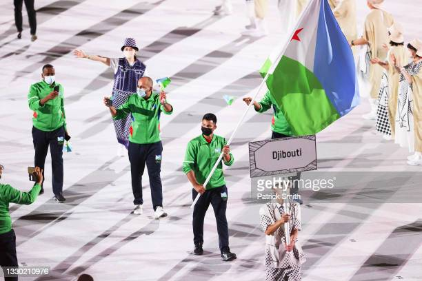 Flag bearer Aden-Alexandre Houssein of Team Djibouti during the Opening Ceremony of the Tokyo 2020 Olympic Games at Olympic Stadium on July 23, 2021...