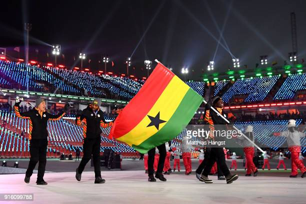 Flag bearer Akwasi Frimpong of Ghana and teammates enter the stadium during the Opening Ceremony of the PyeongChang 2018 Winter Olympic Games at...