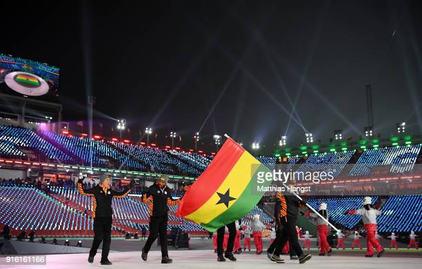 Flag bearer Akwasi Frimpong of Ghana and teammates wave to fans during the Opening Ceremony of the PyeongChang 2018 Winter Olympic Games at...