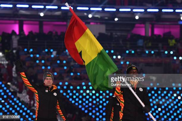 Flag bearer Akwasi Frimpong of Ghana leads out his country during the Opening Ceremony of the PyeongChang 2018 Winter Olympic Games at PyeongChang...