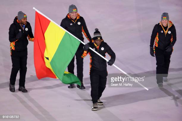 Flag bearer Akwasi Frimpong of Ghana leads the team in the Parade of Athletes during the Opening Ceremony of the PyeongChang 2018 Winter Olympic...
