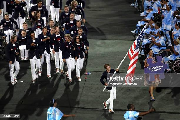 Flag bearer Allison Jones leads Team USA during the Opening Ceremony of the Rio 2016 Paralympic Games at Maracana Stadium on September 7 2016 in Rio...