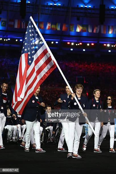 Flag bearer Allison Jones of the United States leads the team entering the stadium during the Opening Ceremony of the Rio 2016 Paralympic Games at...