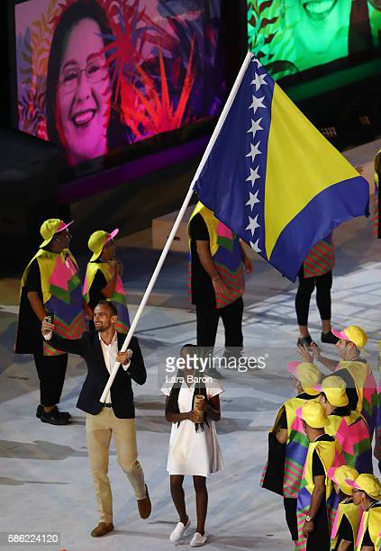 Flag bearer Amel Tuka of Bosnia and Herzegovina takes a selfie while entering the stadium during the Opening Ceremony of the Rio 2016 Olympic Games...