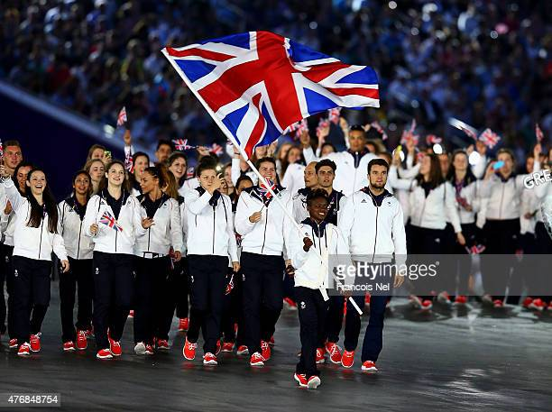 flag bearer and boxer Nicola Adams of Great Britain leads her team into the stadium during the Opening Ceremony for the Baku 2015 European Games at...