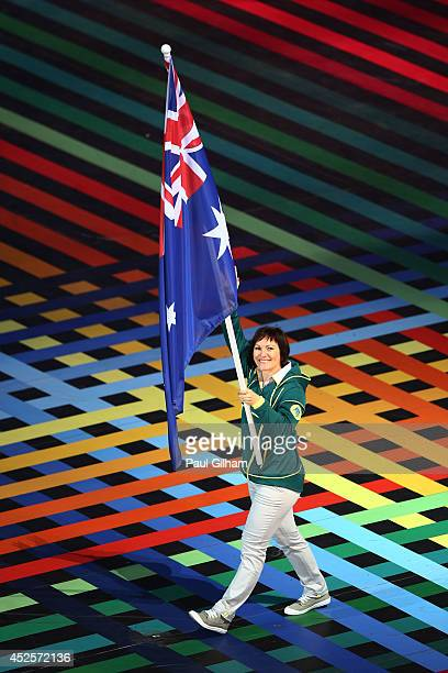 Flag bearer and Cyclist Anna Meares of Australia during the Opening Ceremony for the Glasgow 2014 Commonwealth Games at Celtic Park on July 23 2014...