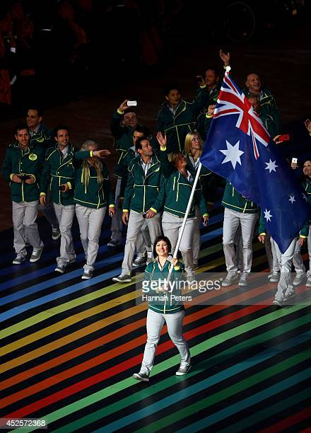Flag bearer and Cyclist Anna Meares of Australia leads the athletes during the Opening Ceremony for the Glasgow 2014 Commonwealth Games at Celtic...