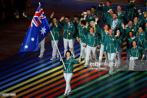 Flag bearer and Cyclist Anna Meares of Australia leads the Australian athletes during the Opening Ceremony for the Glasgow 2014 Commonwealth Games at...