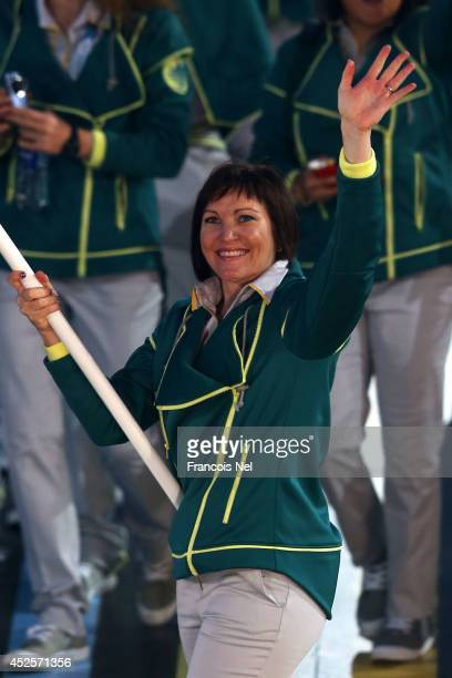 Flag bearer and Cyclist Anna Meares of Australia waves during the Opening Ceremony for the Glasgow 2014 Commonwealth Games at Celtic Park on July 23,...