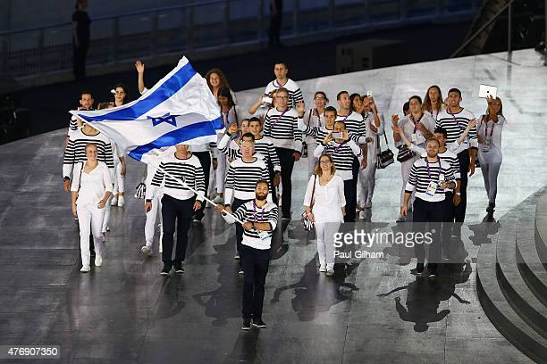 Flag bearer and gymnast Alexander Shatilov of Israel leads his team into the stadium during the Opening Ceremony for the Baku 2015 European Games at...