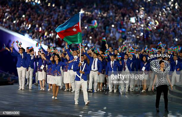 flag bearer and Judoka Elmar Gasimov of Azerbaijan leads his team into the stadium during the Opening Ceremony for the Baku 2015 European Games at...