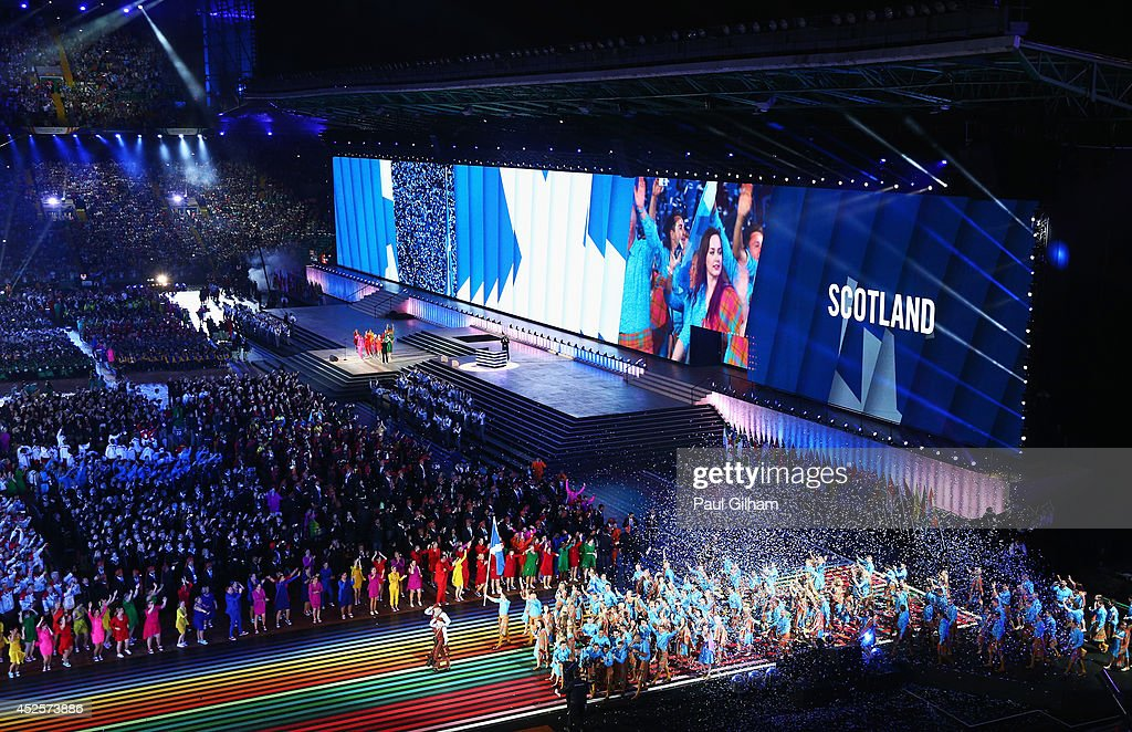 Flag bearer and Judoka Euan Burton of Scotland leads the Scottish athletes during the Opening Ceremony for the Glasgow 2014 Commonwealth Games at Celtic Park on July 23, 2014 in Glasgow, Scotland.