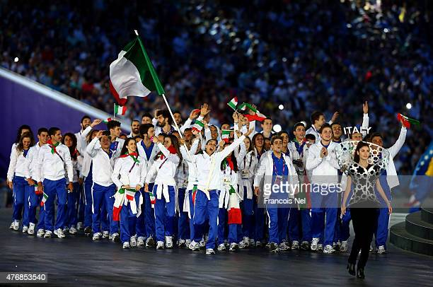 flag bearer and Judoka Giulia Quintavalle of Italy leads her team into the stadium during the Opening Ceremony for the Baku 2015 European Games at...