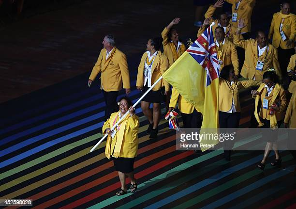 Flag bearer and Lawn Bowler Hina Rereiti of Niue leads the team during the Opening Ceremony for the Glasgow 2014 Commonwealth Games at Celtic Park on...