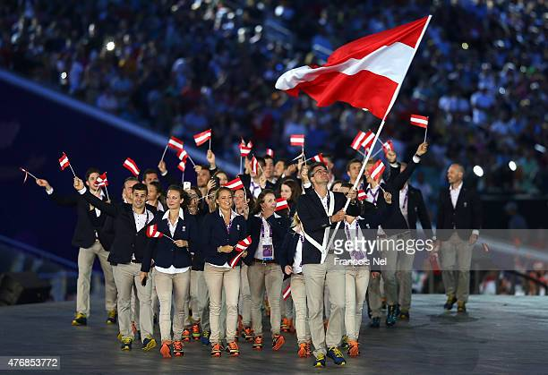 flag bearer and shooter Andreas Scherhaufer of Austria leads his team into the stadium during the Opening Ceremony for the Baku 2015 European Games...