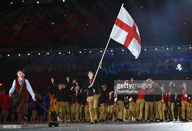 Flag bearer and Squash player Nick Matthew of England during the Opening Ceremony for the Glasgow 2014 Commonwealth Games at Celtic Park on July 23...