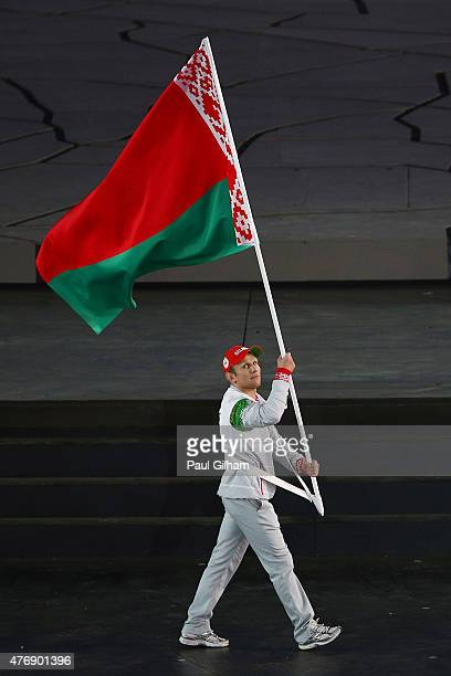 Flag bearer and table tennis player Vladimir Samsonov of Belarus leads his team into the stadium during the Opening Ceremony for the Baku 2015...