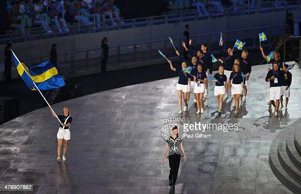 Flag bearer and wrestler Sofia Mattsson of Sweden leads her team into the stadium during the Opening Ceremony for the Baku 2015 European Games at the...