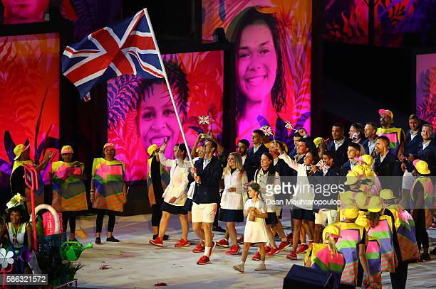 Flag bearer Andy Murray of Great Britain leads his country into the stadium during the Opening Ceremony of the Rio 2016 Olympic Games at Maracana...