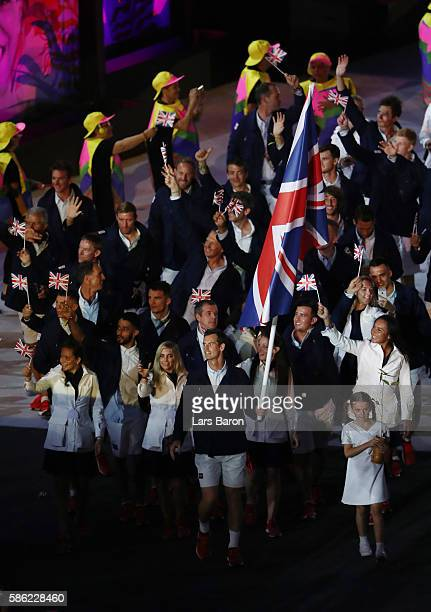 Flag bearer Andy Murray of Great Britain leads the team entering the stadium during the Opening Ceremony of the Rio 2016 Olympic Games at Maracana...