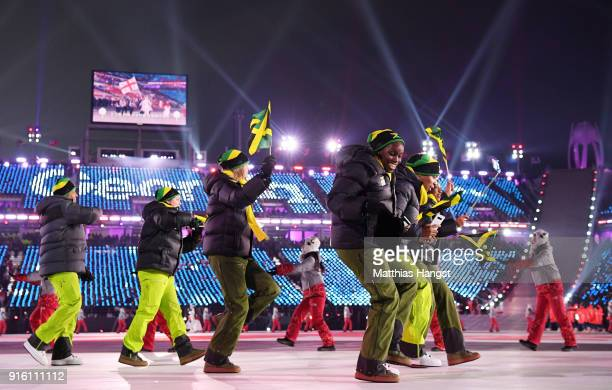 Flag bearer Audra Segree of Jamaica and teammates enter the stadium during the Opening Ceremony of the PyeongChang 2018 Winter Olympic Games at...