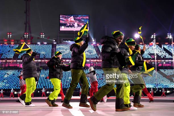 Flag bearer Audra Segree of Jamaica enter the stadium during the Opening Ceremony of the PyeongChang 2018 Winter Olympic Games at PyeongChang Olympic...