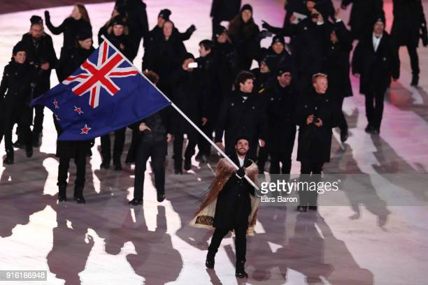 Flag bearer BeauJames Wells of New Zealand leads the team during the Opening Ceremony of the PyeongChang 2018 Winter Olympic Games at PyeongChang...