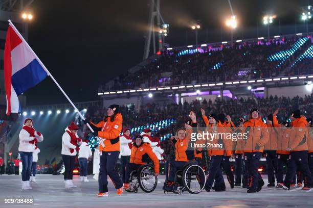 Flag bearer Bibian MentelSpee of the Netherlands leads the team during the opening ceremony of the PyeongChang 2018 Paralympic Games at the...