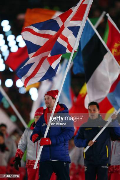 Flag bearer Billy Morgan of Great Britain walks in the Parade of Athletes during the Closing Ceremony of the PyeongChang 2018 Winter Olympic Games at...