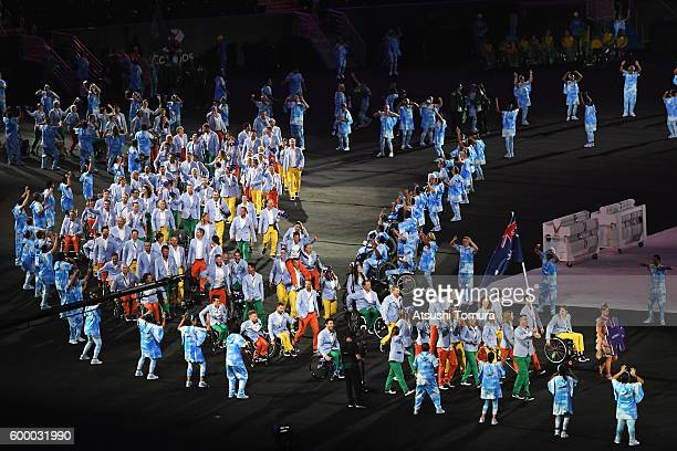 Flag bearer Bradley Ness and Australia team enter the stadium during the Opening Ceremony of the Rio 2016 Paralympic Games at Maracana Stadium on...