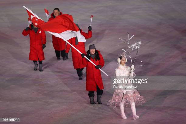 Flag bearer Cheyenne Goh of Singapore leads the team during the Opening Ceremony of the PyeongChang 2018 Winter Olympic Games at PyeongChang Olympic...