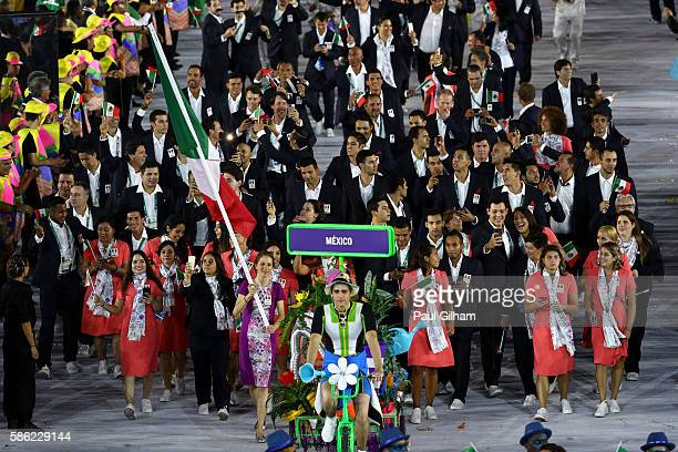 Flag bearer Daniela Campuzano of Mexico leads her team during the Opening Ceremony of the Rio 2016 Olympic Games at Maracana Stadium on August 5 2016...