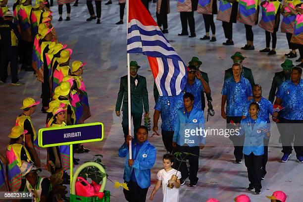 Flag bearer David Katoatau of Kiribati leads his team during the Opening Ceremony of the Rio 2016 Olympic Games at Maracana Stadium on August 5 2016...