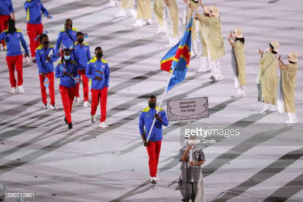 Flag bearer David Tshama Mwenekabwe of Team Democratic Republic of the Congo during the Opening Ceremony of the Tokyo 2020 Olympic Games at Olympic...