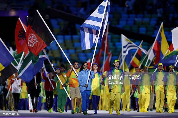"""Flag bearer Ekaterini Stefanidi of Greece walks in the """"Heroes of the Games"""" segment during the Closing Ceremony on Day 16 of the Rio 2016 Olympic..."""