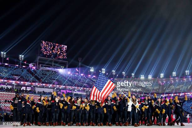 Flag bearer Erin Hamlin of the United States and teammates enter the stadium during the Opening Ceremony of the PyeongChang 2018 Winter Olympic Games...