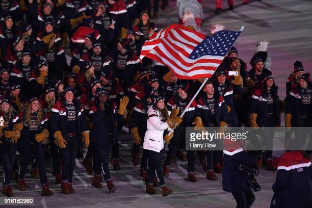 Flag bearer Erin Hamlin of the United States leads her country during the Opening Ceremony of the PyeongChang 2018 Winter Olympic Games at...