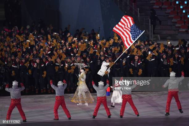 Flag bearer Erin Hamlin of the United States leads the team in the Parade of Athletes during the Opening Ceremony of the PyeongChang 2018 Winter...