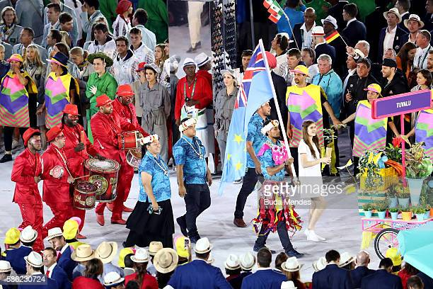 Flag bearer Etimoni Timuani of Tuvalu leads his team during the Opening Ceremony of the Rio 2016 Olympic Games at Maracana Stadium on August 5 2016...